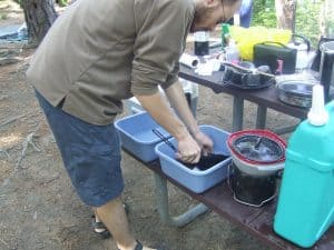 Washing Dishes at Camp