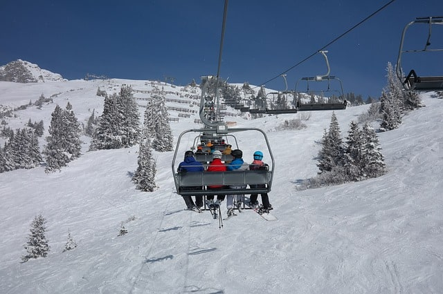 Family on the ski lift going up the mountain