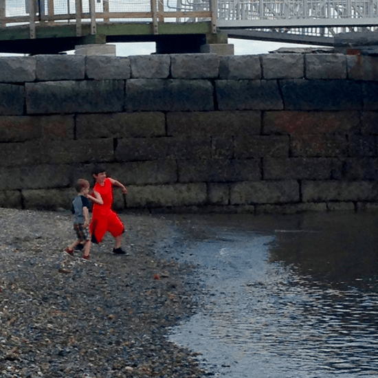Throwing rocks into Boston Harbor on George's Island