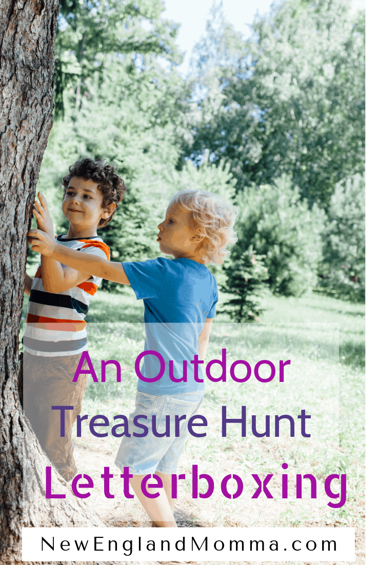 two boys searching a tree for letterboxing
