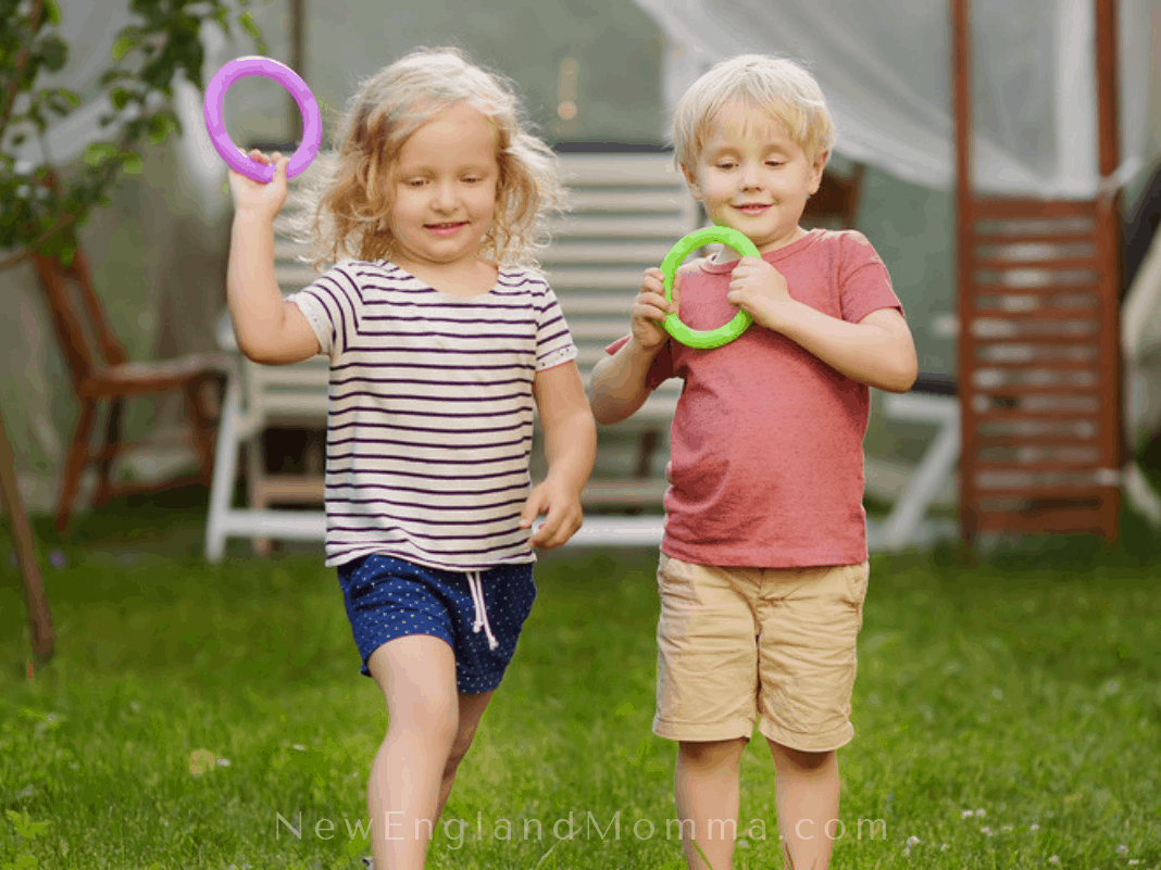 Two kids playing ring toss - playing games while camping