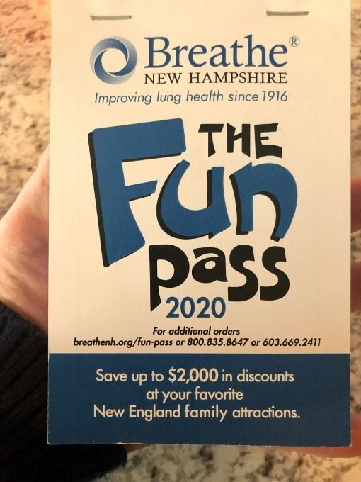 a coupon book called the fun pass in a person's hand