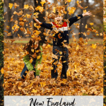two boys throwing leaves over their heads at fall time