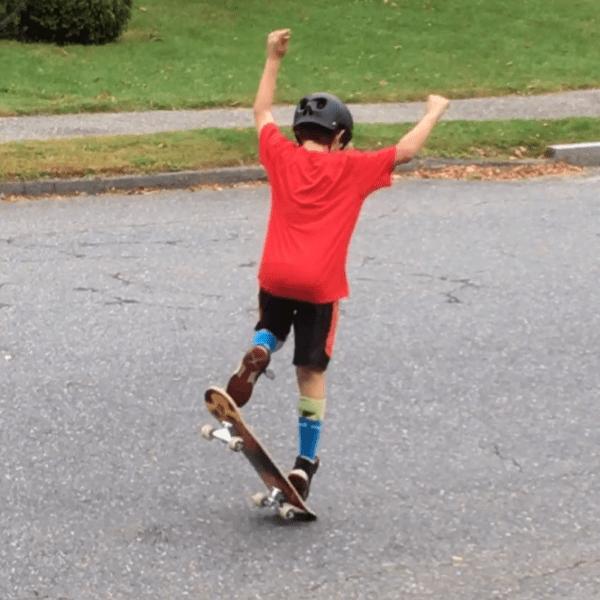 a tween boy on his skate board