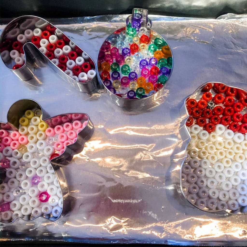 Christmas themed ornaments with colorful pony beads in them