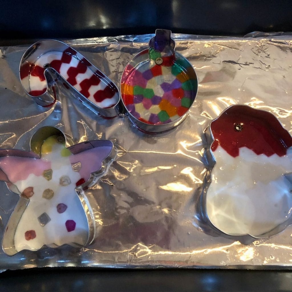Christmas themed cookie cutters with melted beads i