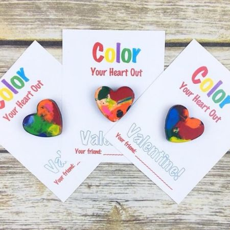 colorful crayons in the shape of a heart on white Valentine's Day cards