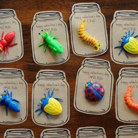 colorful bug toys on mason jar paper cutouts