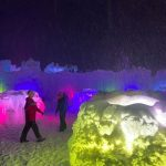 walls of ice lit up by colorful fluorescent lights