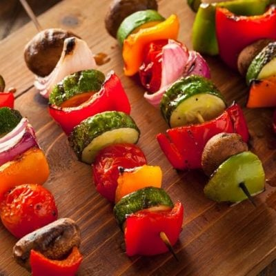cut up vegetables on skewers