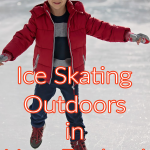 young boy ice skating outdoors in winter