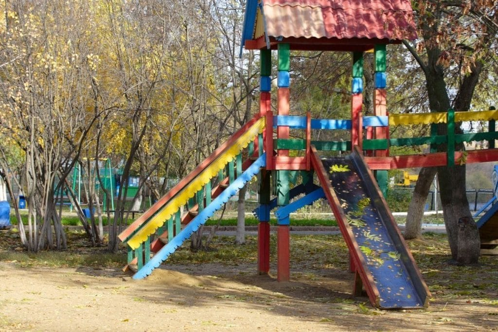 A colorful wooden playground at a campground