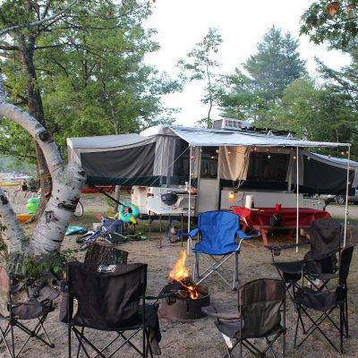 pop up trailer at a campground