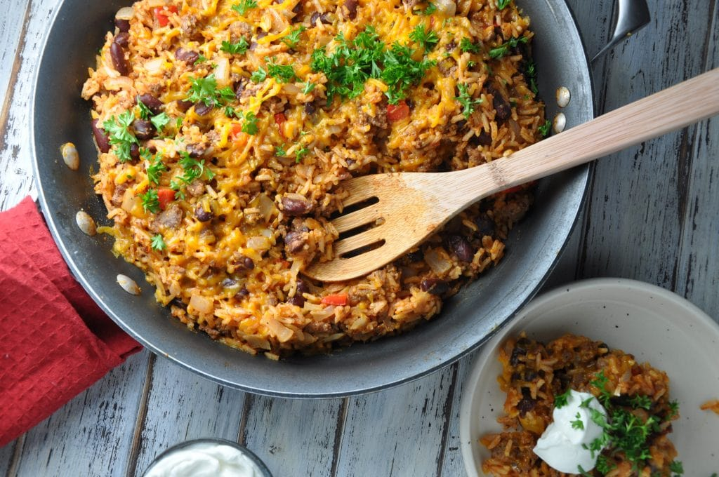 Cheesy rice and ground beef dinner in a skillet