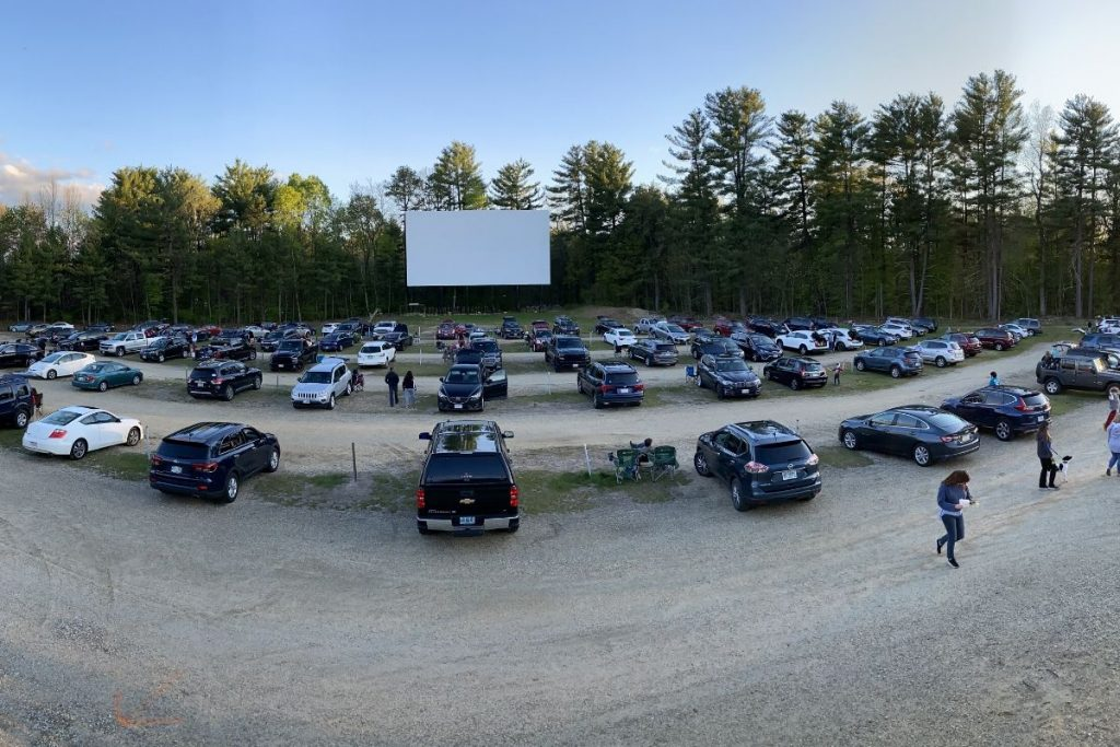 Cards spaced out at a drive-in movie theatre