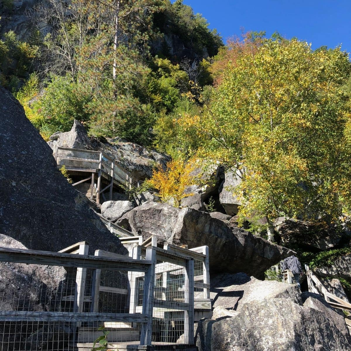 stairs going up to caves in a mountain