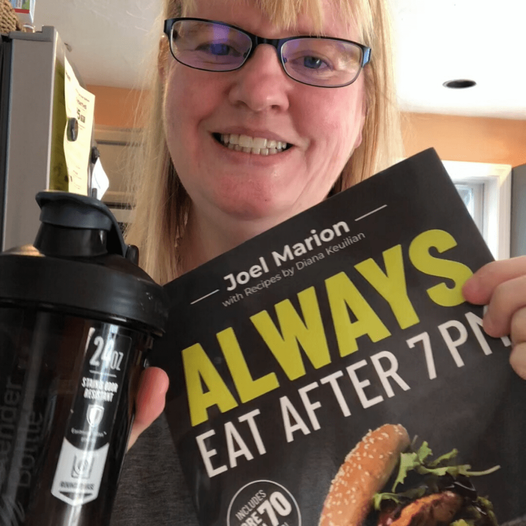woman with a water bottle and diet book