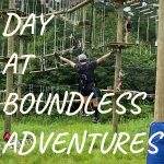 a boy zip lining down on an aerial rope course at Boundless Adventures