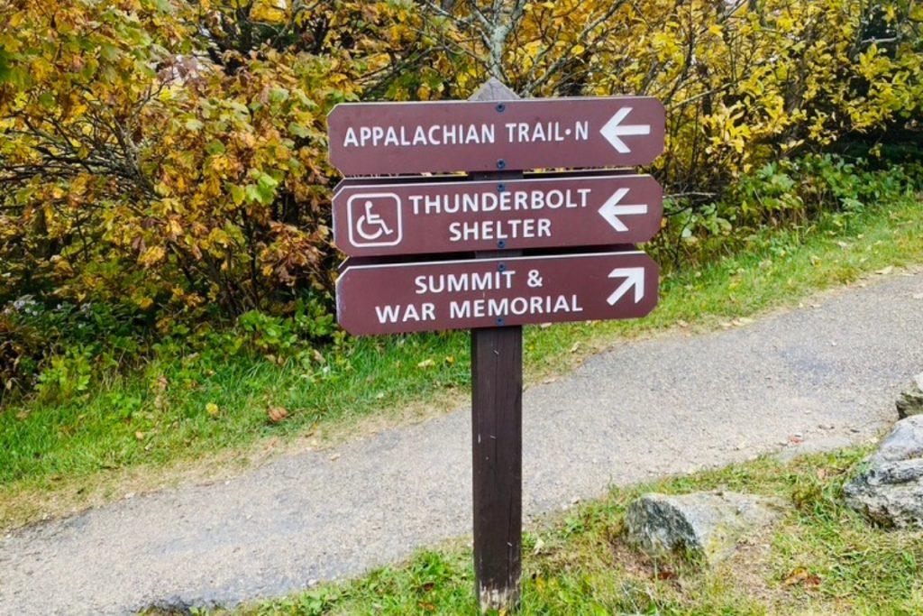 A sign post showing which way to walk if you want to hike the Appalachian trail or go to the summit of Mt Greylock