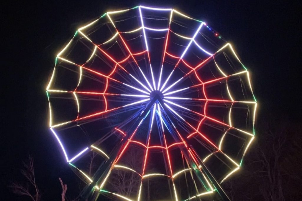 An 85 foot Ferris wheel lit up for Christmas time