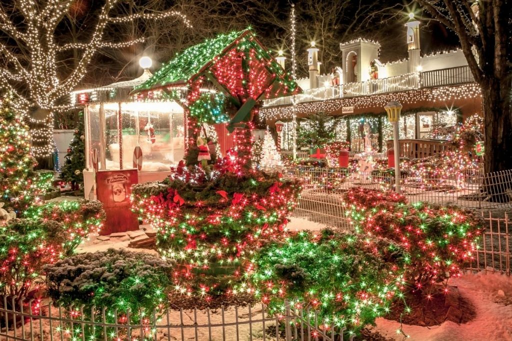 A festive outdoor stores decked out in white, red and white lights for the holiday season