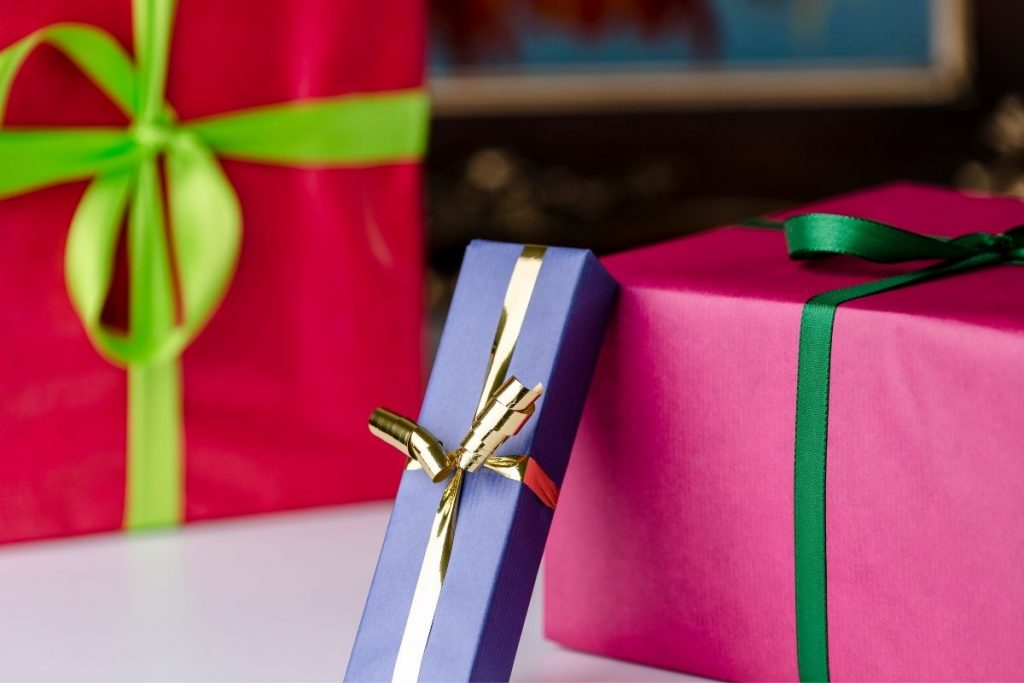 Three gift boxes wrapped with  bows