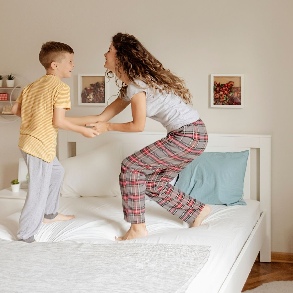 mom and son celebrating the bedroom is clean